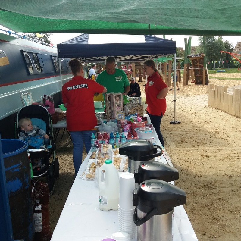 Our volunteers are setting up the tombola and tuck shop stalls.